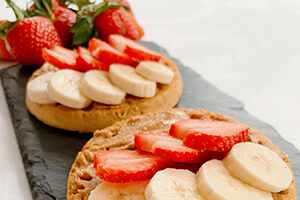 a nut butter waffle with strawberry and banana